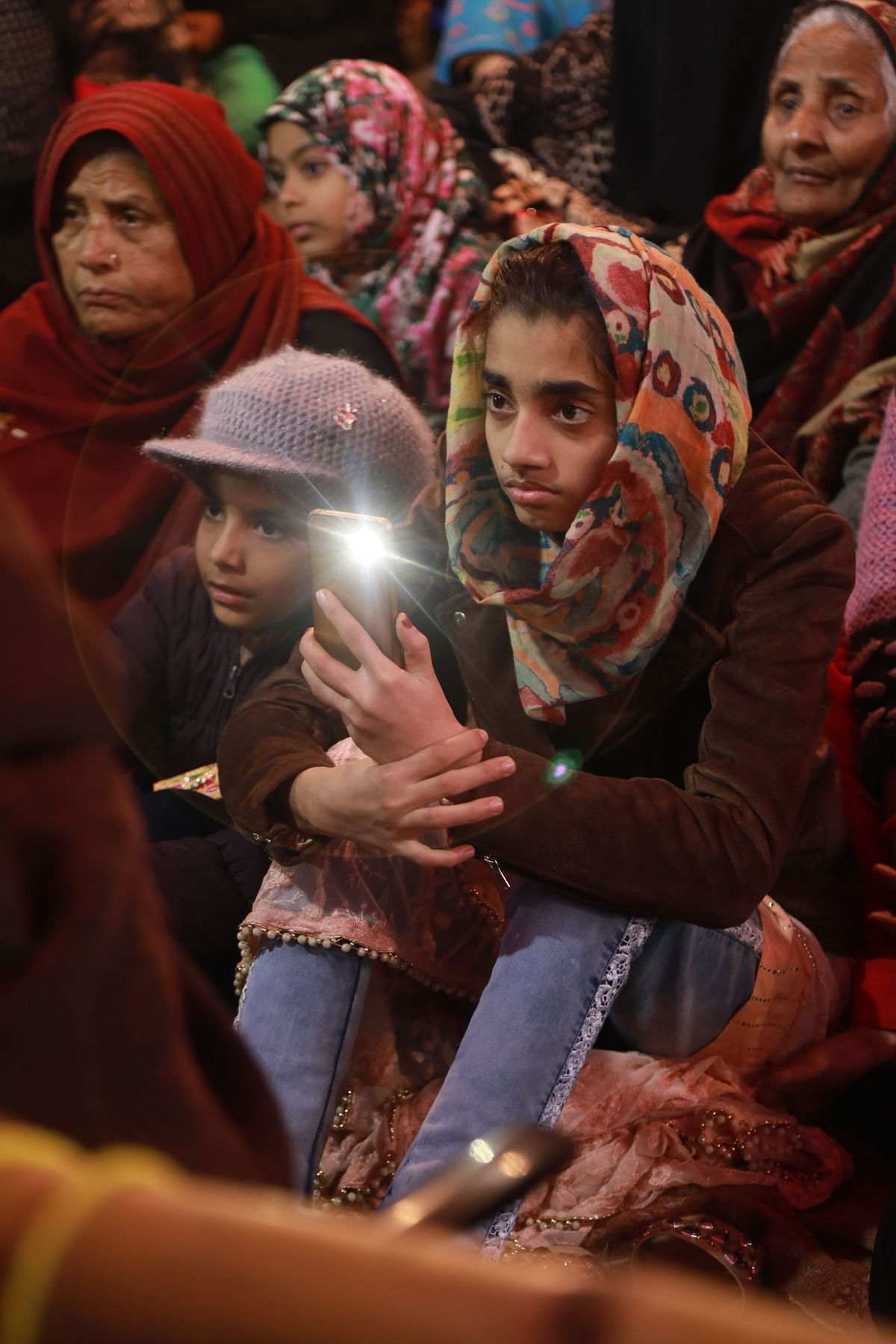Women bring their children to the protests. The 24/7 protest began on 15 December.
