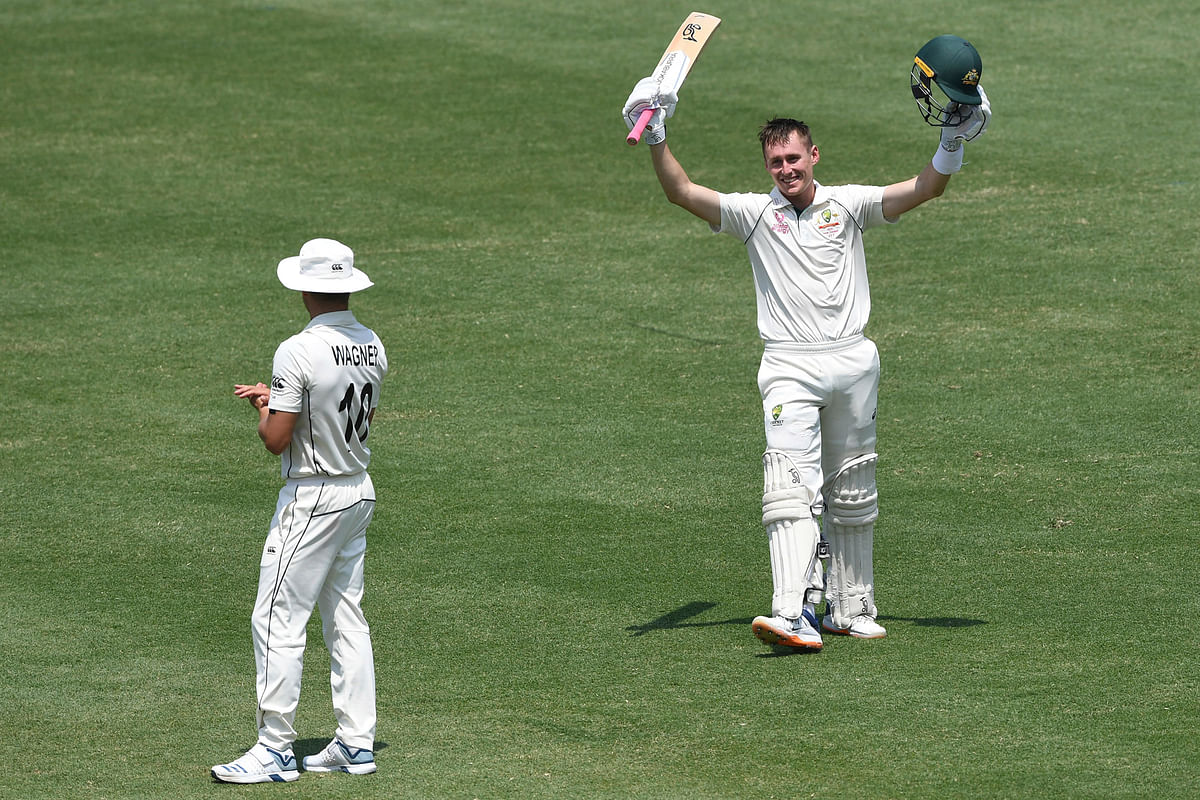 Australia's Marnus Labuschagne celebrates his double century 200 not out as Neil Wagner looks on during play on day two of the third cricket test match between Australia and New Zealand.