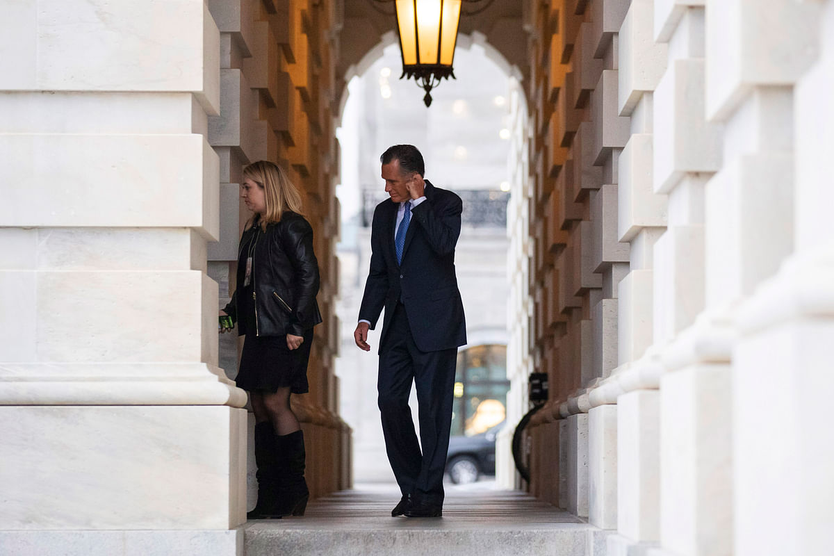 Mitt Romney, right, departs after the impeachment acquittal of President Donald Trump, on Capitol Hill, Wednesday, 5 Feb 2020.