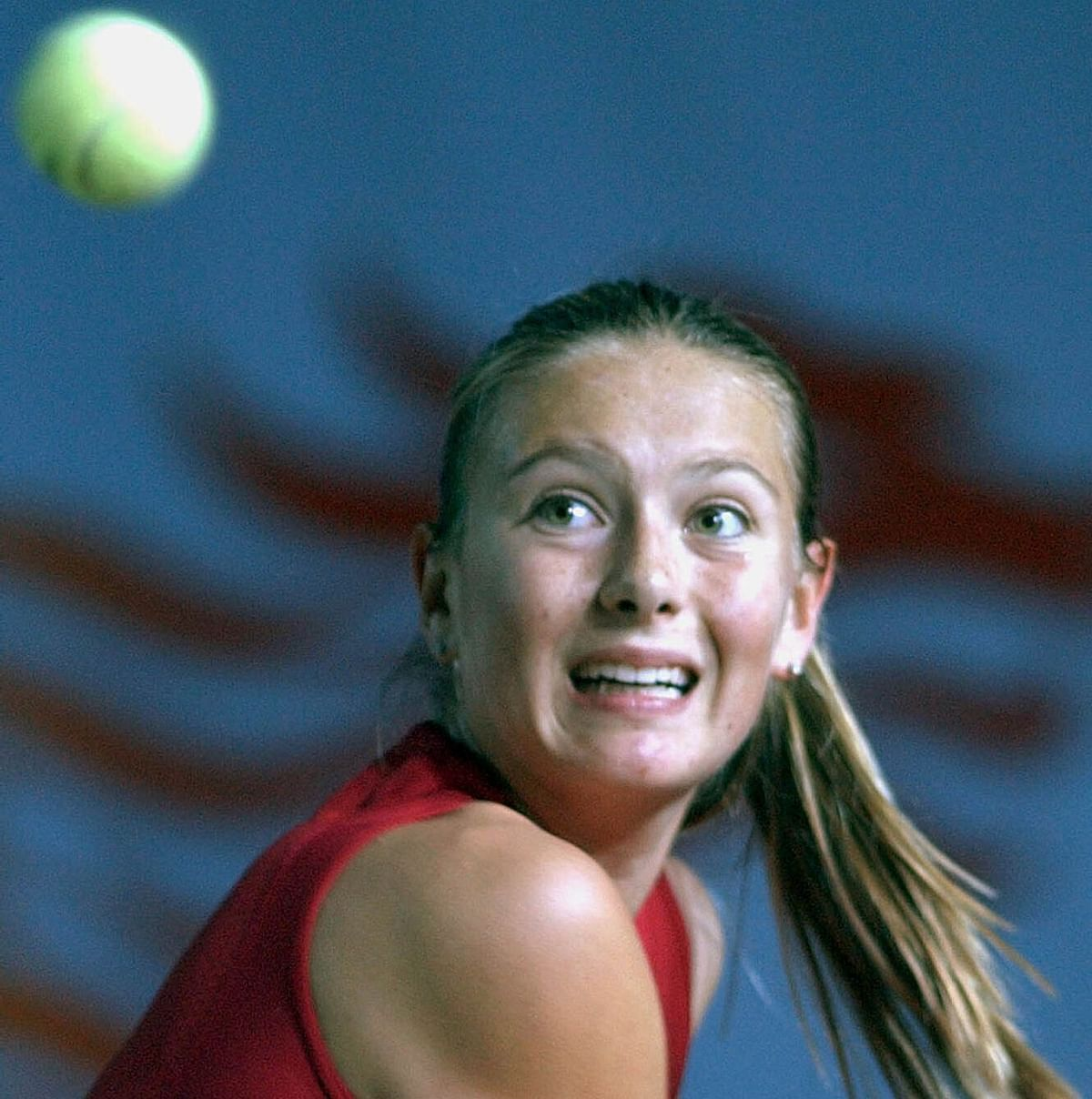 In this Jan. 3, 2003, file photo, Maria Sharapova of Russia eyes to the ball during her semifinal match against Monica Seles of the United States in the Hong Kong Ladies Challenge tennis tournament in Hong Kong.