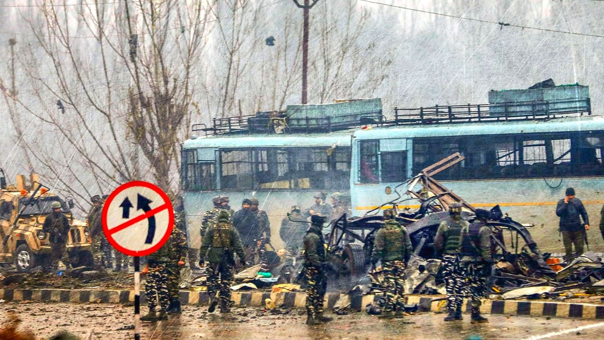 Security personnel carry out rescue and relief work at the site of the suicide bomb attack in Pulwama district of J&K on 14 February.