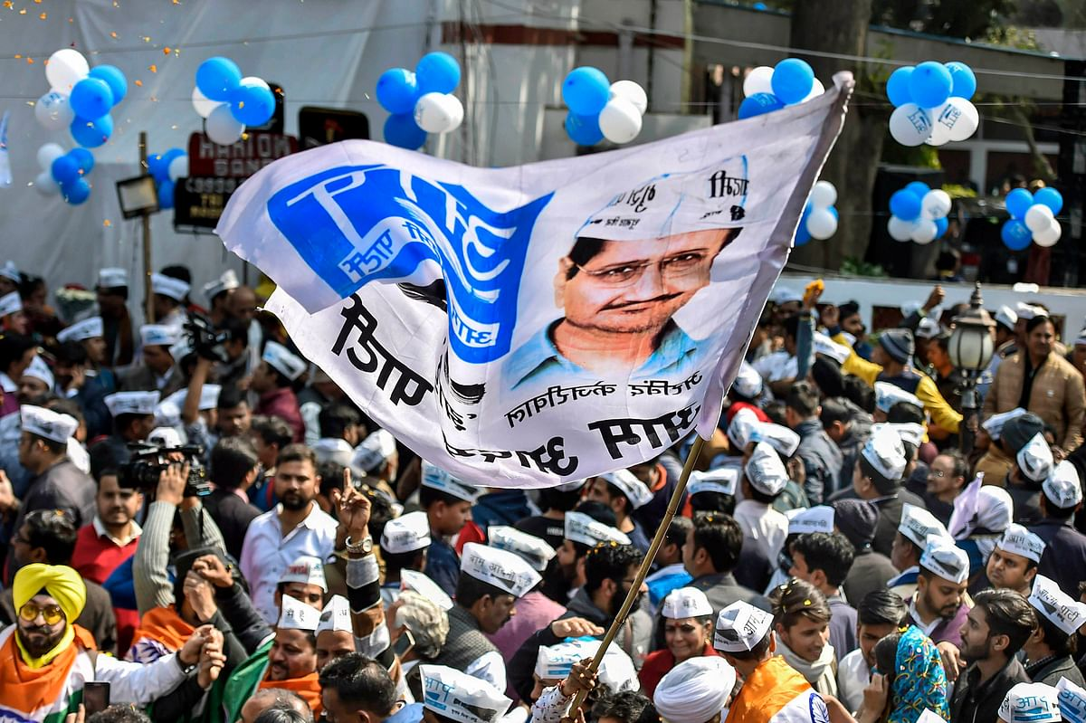 Aam Aadmi Party workers celebrate before the party's victory in the Delhi Assembly polls, at party headquarters in New Delhi.