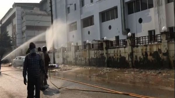 Firefighters, who responded to the emergency, had diluted the ammonia gas which had got mixed in the air in and around the building, a Fire Department official said.