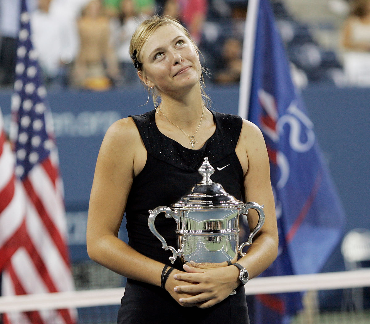 In this Sept. 9, 2006, file photo, Maria Sharapova looks up to the crowd after winning the women's singles championship over Justin Henin-Hardenne of Belgium at the U.S. Open tennis tournament in New York.