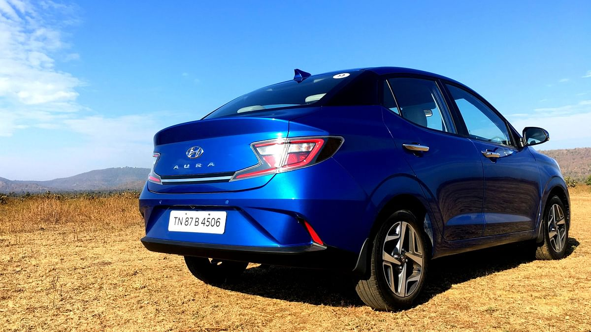 The LED tail-lamps and Z-shaped styling of the Hyundai Aura's rear.