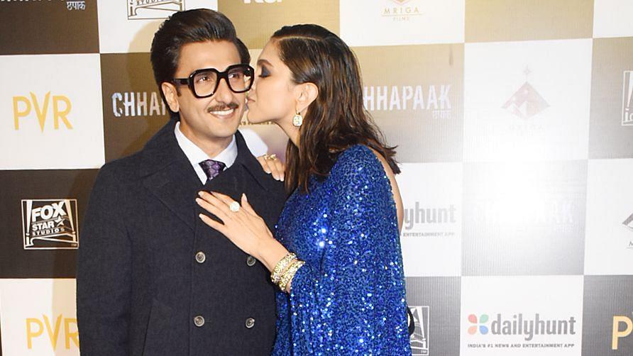 Deepika Padukone kisses Ranveer Singh at the special screening of <i>Chhapaak</i>.