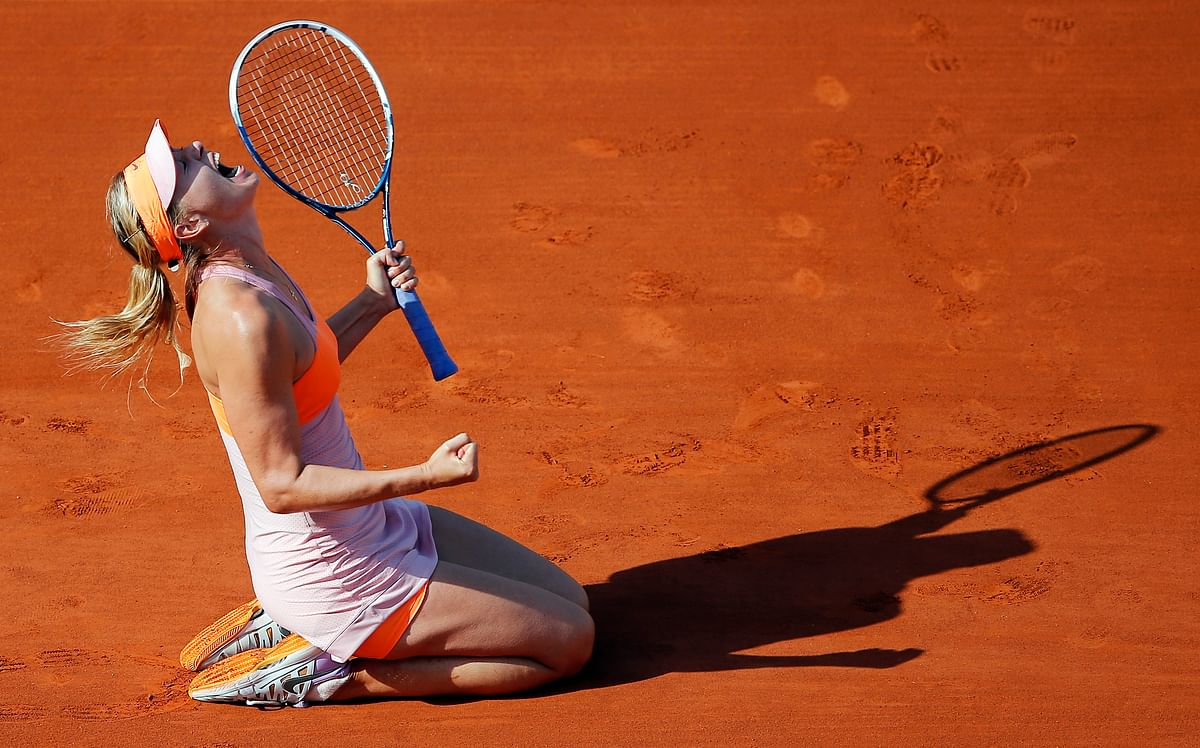 In this Jule 7, 2014, file photo, Russia's Maria Sharapova reacts after defeating Romania's Simona Halep during their final match of the French Open tennis tournament at the Roland Garros stadium, in Paris, France.