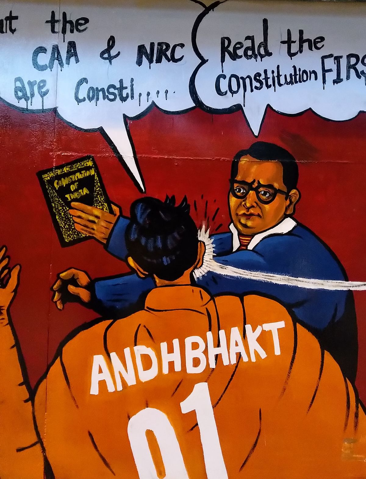 This artwork outside Jamia shows BR Ambedkar responding to the CAA with the Constitution.