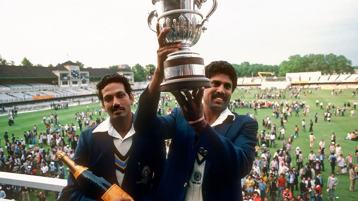 Kapil Dev holds aloft the winner's trophy at the 1983 ICC World Cup.
