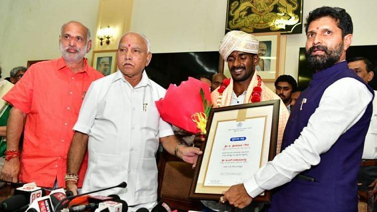 28-year-old Kambala jockey Srinivas Gowda meets CM Yediyurappa.