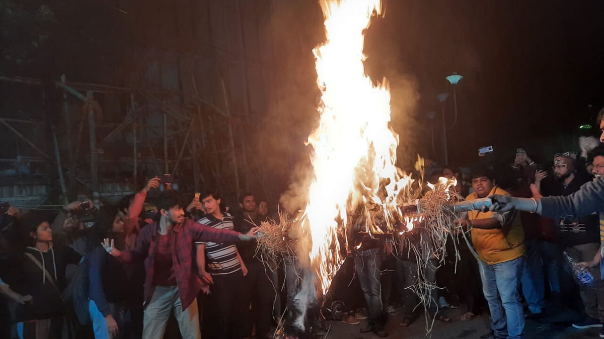 Students burn an effigy of Home Minister Amit Shah during a protest against CAA and NRC.