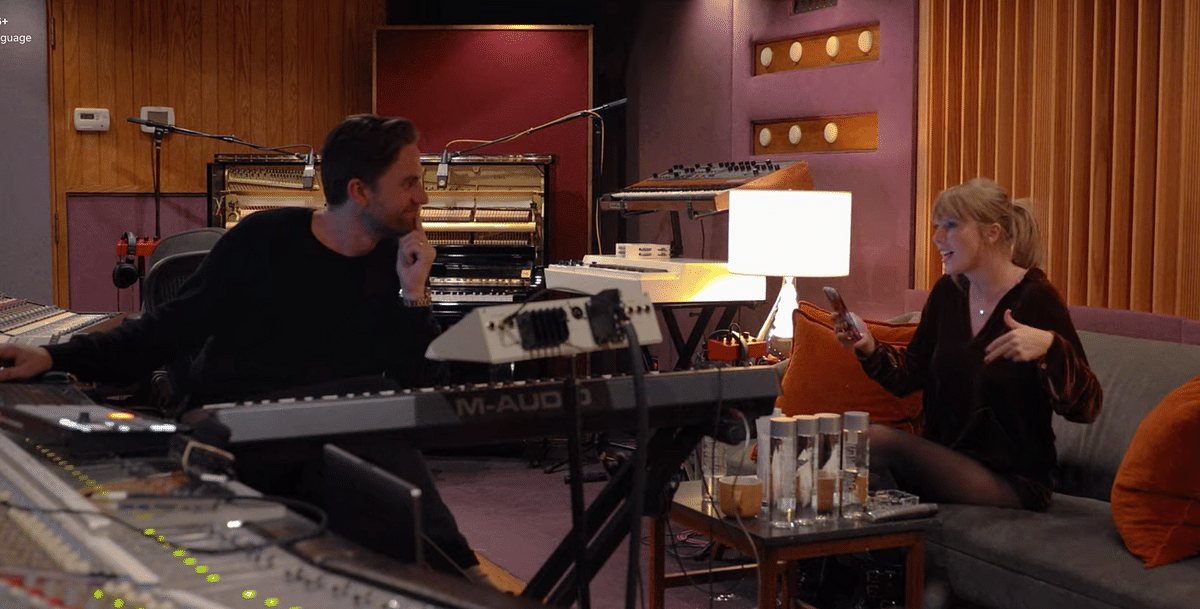 Taylor Swift jamming with a colleague.