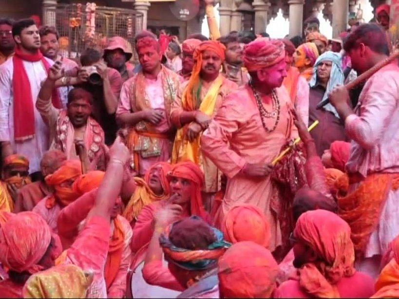Laddu Holi being celebrated in Mathura.