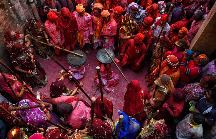 Lathmar holi being celebrated, where women of Barsana beat men from nearby villages.