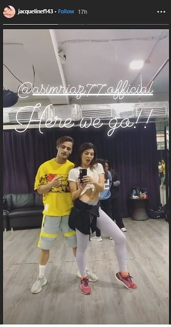 Jacqueline and Asim rehearsing in a dance studio.