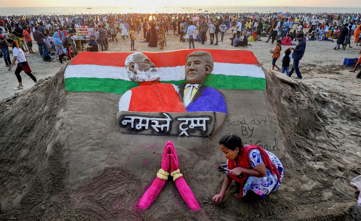 Sand artist Laxmi Gaud creates a sculpture of Prime Minister Narendra Modi and US President Donald Trump on the eve of latters maiden visit to India, at Juhu Beach in Mumbai, Sunday, 23 February.