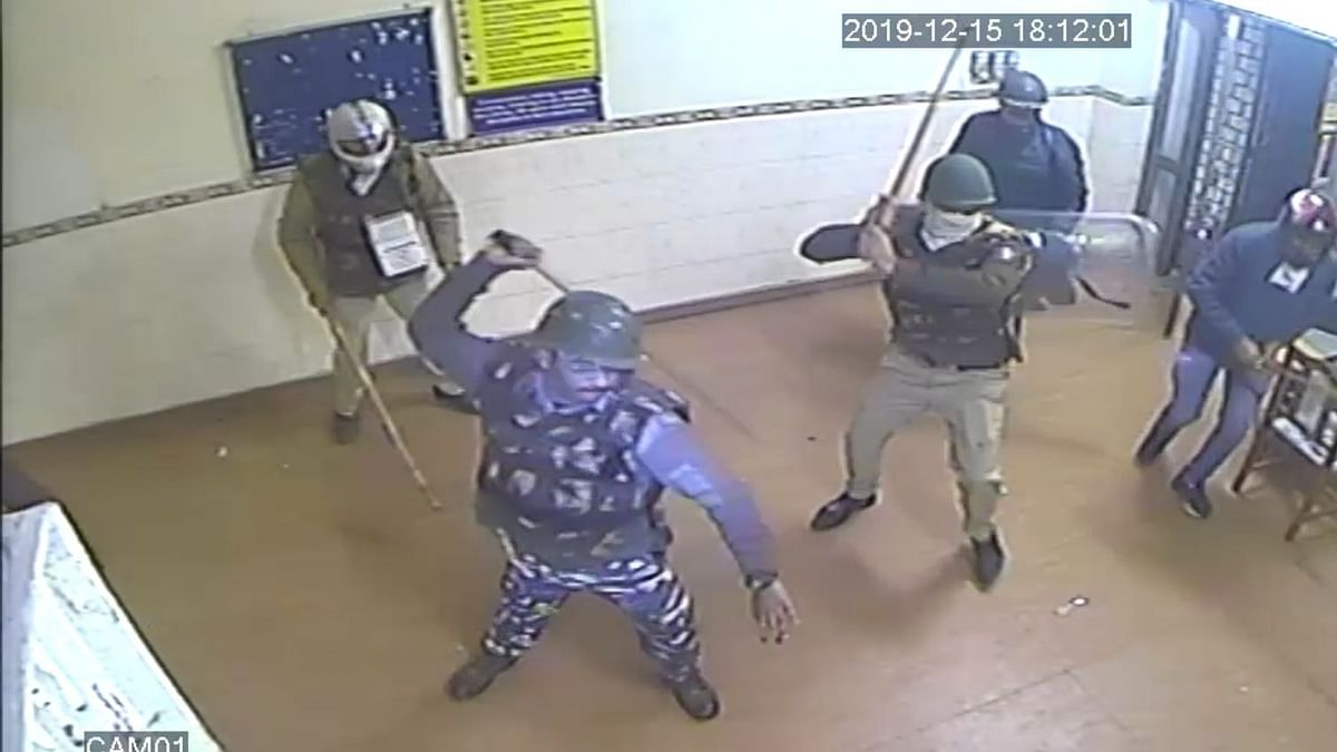 Armed policemen enter the reading hall and beat up students.