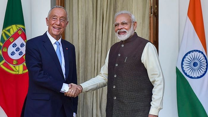 Prime Minister Narendra Modi (R) shakes hands with Portuguese President Marcelo Rebelo de Sousa prior to a meeting at Hyderabad House, in New Delhi, Friday, 14 February.