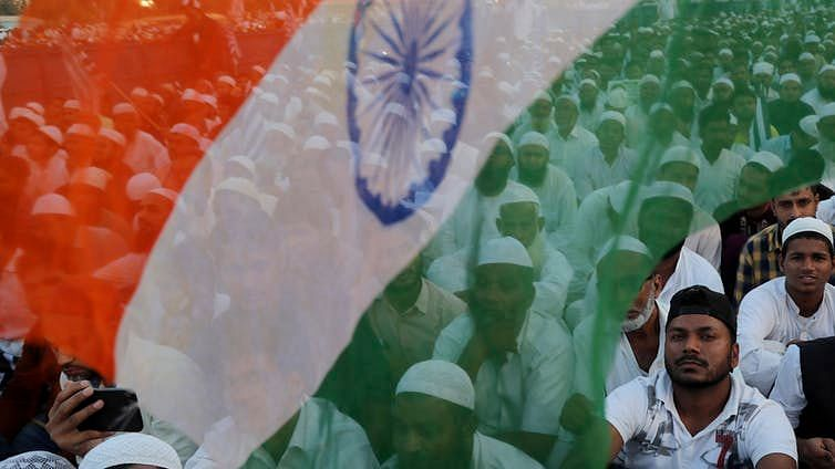 Indian Muslims participate in a protest against a new citizenship law.