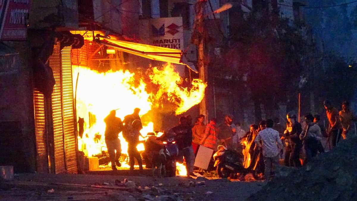Rioters set ablaze a shop during clashes between those against and those supporting the Citizenship (Amendment) Act in at Gokalpuri in northeast Delhi.