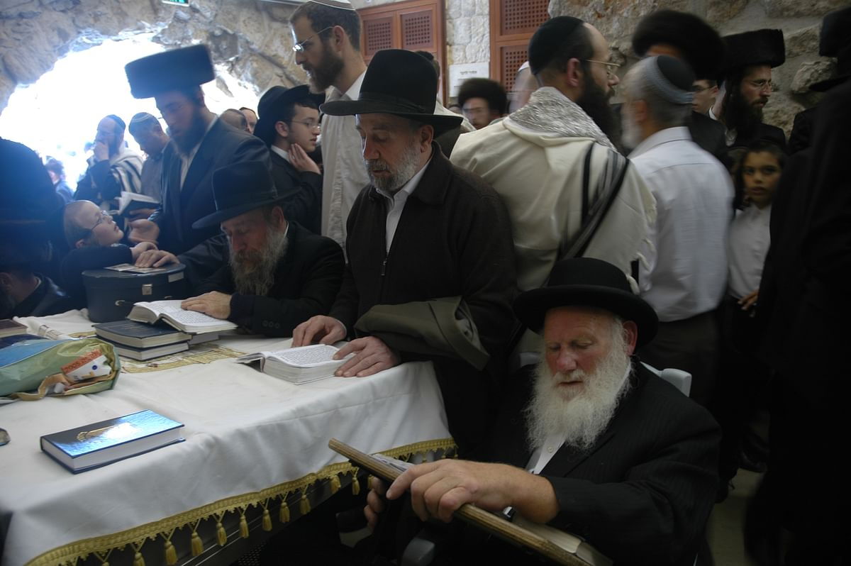 Orthodox Jews live in strict accordance with the halacha, the Jewish religious code first transmitted by God to Moses.