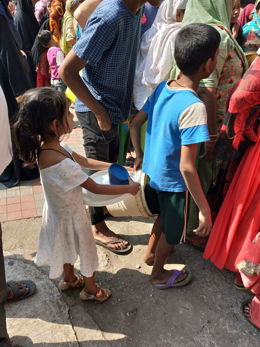 Even children are lining up to get water.