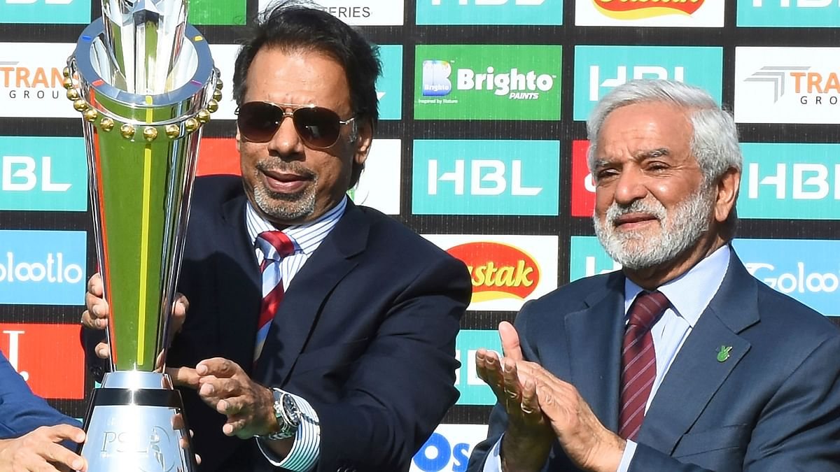 Pakistan's former squash world champion Jahangir Khan unveils the PSL trophy at the National Stadium in Karachi, Pakistan with Chief of Pakistan Cricket Board Ehsan Mani, right, Wednesday, Feb. 19, 2020.