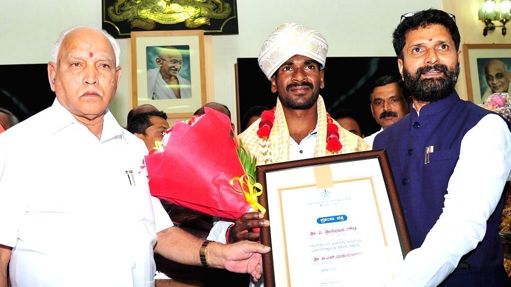 Srinivasa Gowda was handed a cheque of Rs 3 lakh  by Karnataka chief minister BS Yediyurappa on Monday.
