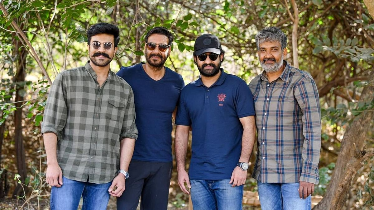 SS Rajamouli on the sets of <i>RRR&nbsp;</i>with Jr NTR and Ajay Devgn.