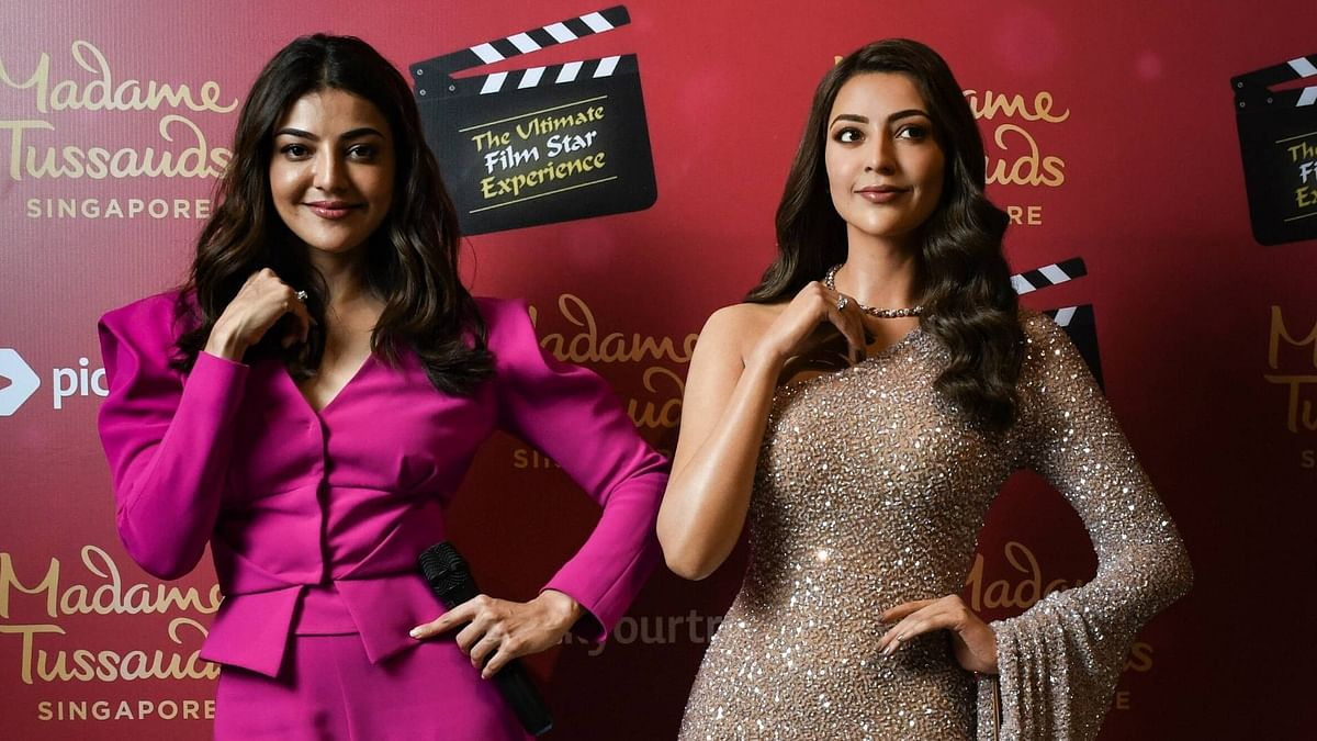 Actor Kajal Aggarwal with her wax statue at Madame Tussauds Singapore.