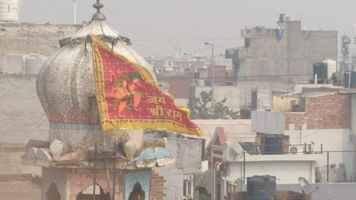 A day after a mosque was vandalised and set on fire in Ashok Nagar's Gali No 5, the saffron flag placed on the dome of the mosque minar remains hoisted.