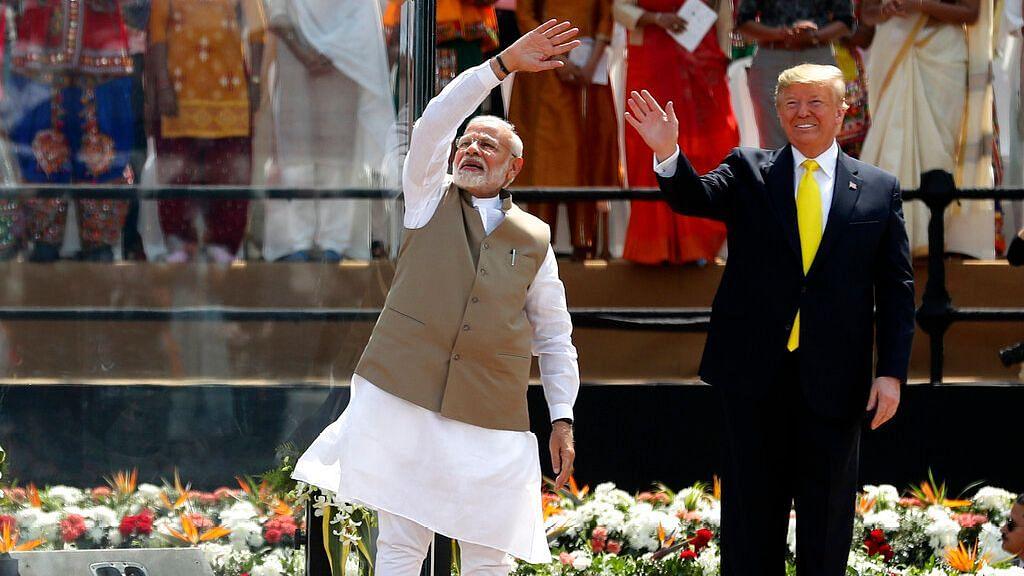 U.S. President Donald Trump and Indian Prime Minister Narendra Modi wave to the crowd at Sardar Patel Stadium in Ahmedabad, India, Monday, Feb. 24, 2020.