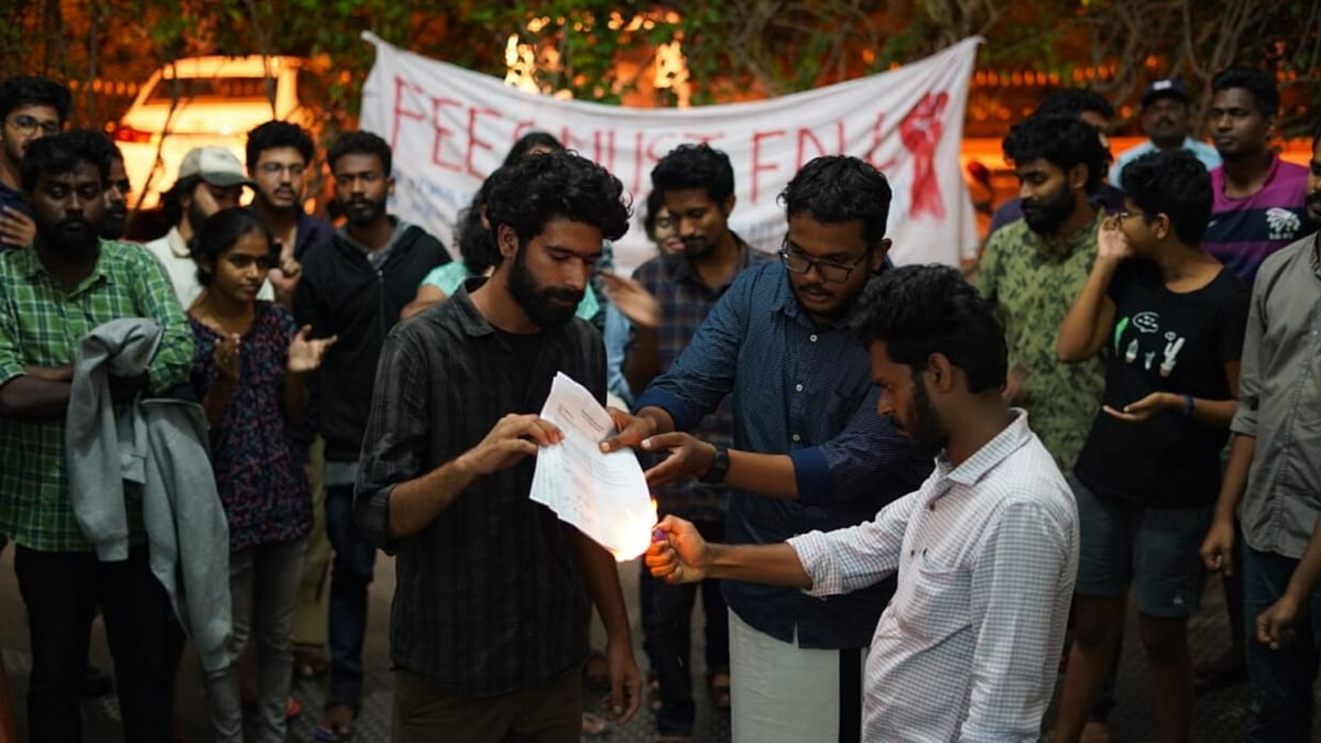 Parichay Yadav, President of the student council holding the circular as it is being burnt in a symbolic gesture.