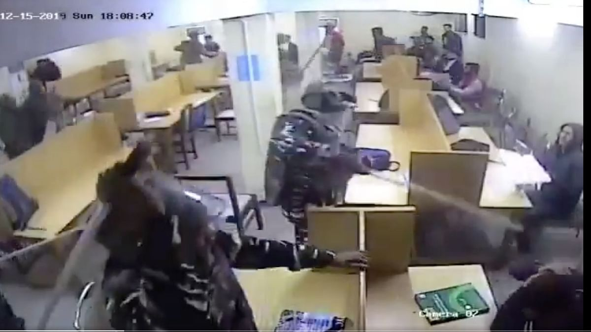 The video shows armed policemen entering a hall and thrashing students who were purportedly studying there.