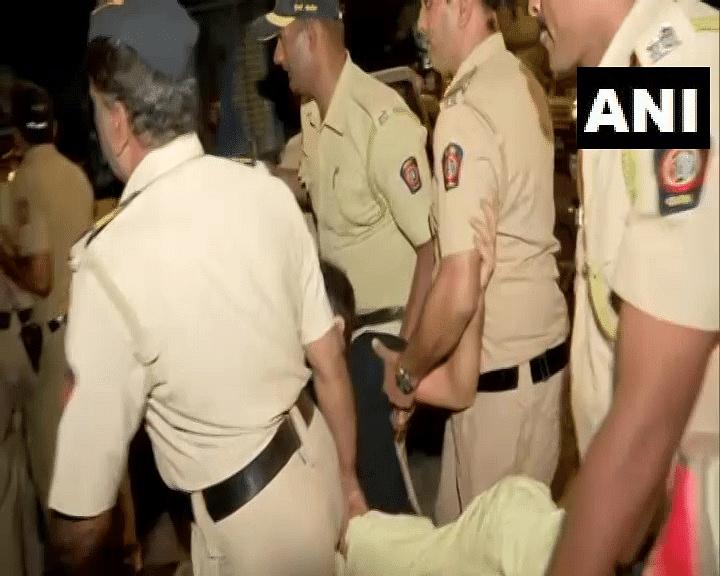 Mumbai police detains protesters at Marine Drive.