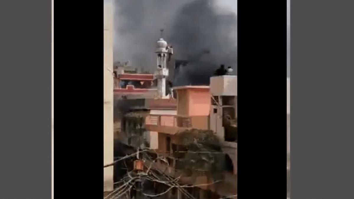 Viral Clip Shows Rioters Vandalising Mosque, Hoisting Saffron Flag