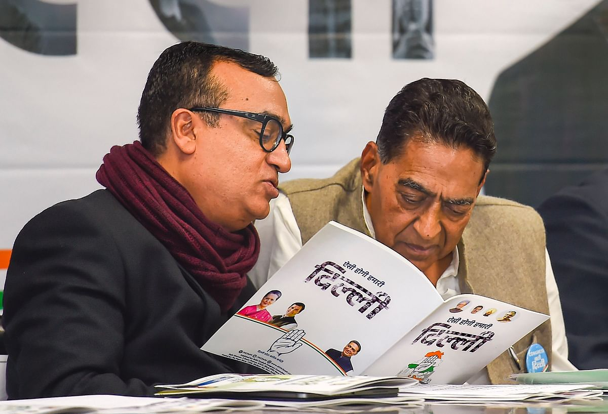DPCC President Subhash Chopra (R) with party leader Ajay Maken at the release of the Congress manifesto for the Delhi Assembly elections, at a press conference at the DPCC office, in New Delhi, Sunday, Feb. 2, 2020.