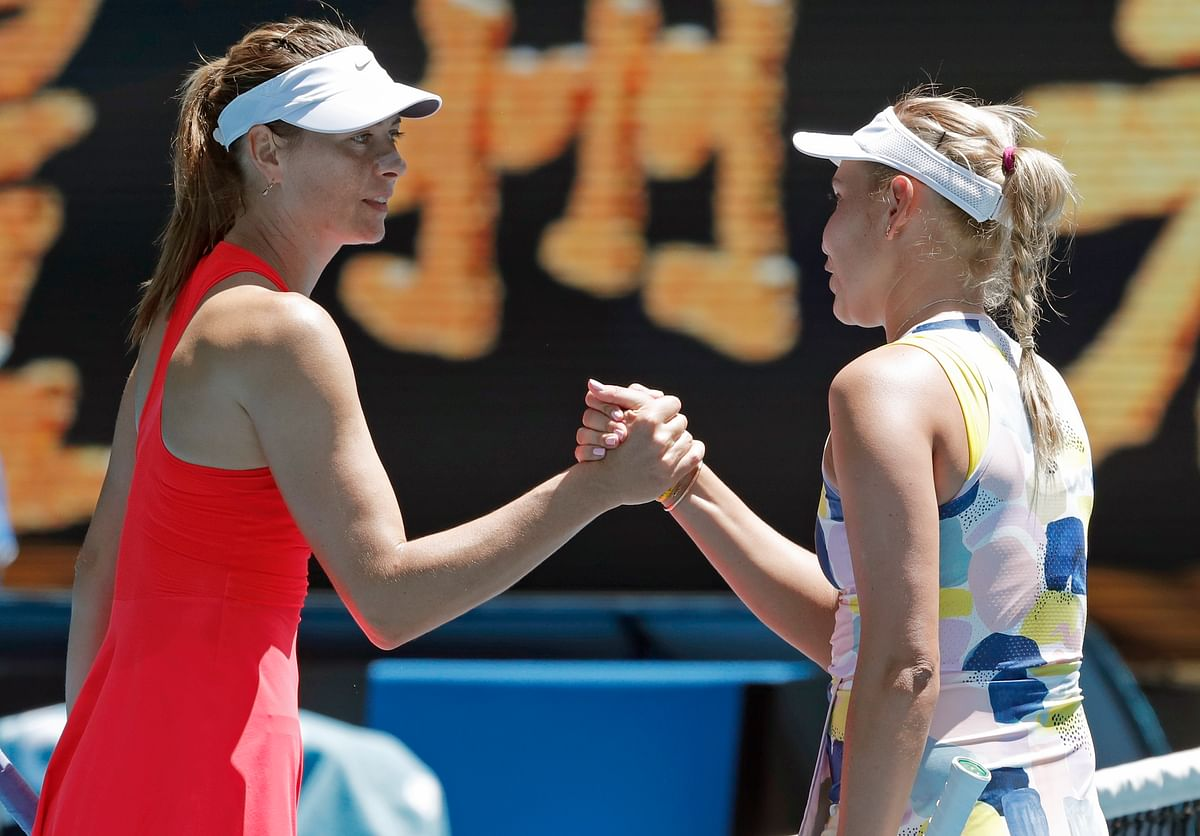 Russia's Maria Sharapova, left, congratulates Croatia's Donna Vekic after winning their first round singles match at the Australian Open tennis championship in Melbourne, Australia, Tuesday, Jan. 21, 2020.