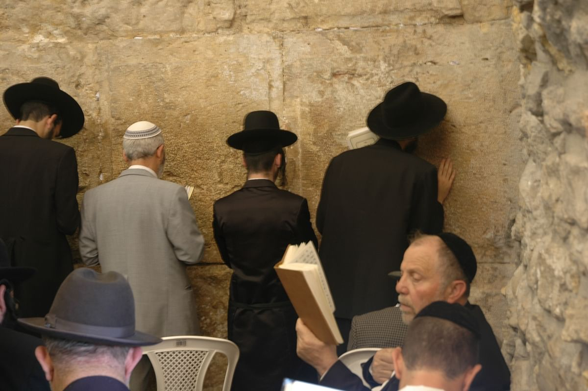 Western Wall, a focal point for Jewish prayer and pilgrimage, where Jews lament the destruction of their Temple.