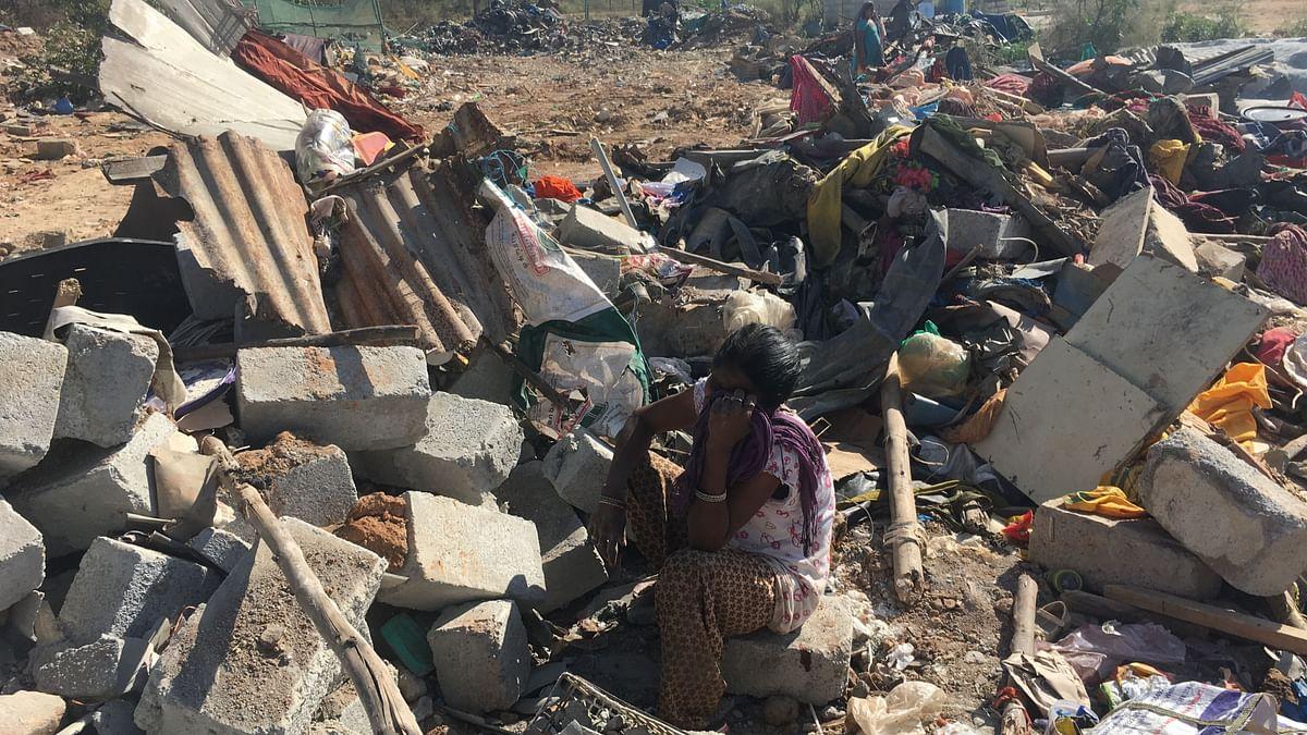 Sabina, 45, sits amid the rubble of her home in Munnekola near Marathahalli, in east Bengaluru.