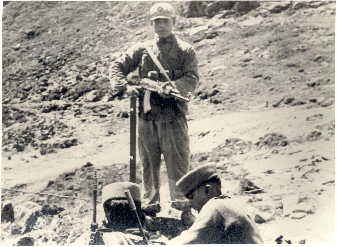 A Chinese soldier objecting to Indian soldiers building iron pickets along the border.