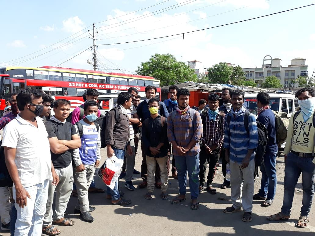 Labourers waiting for a bus in Ranchi.