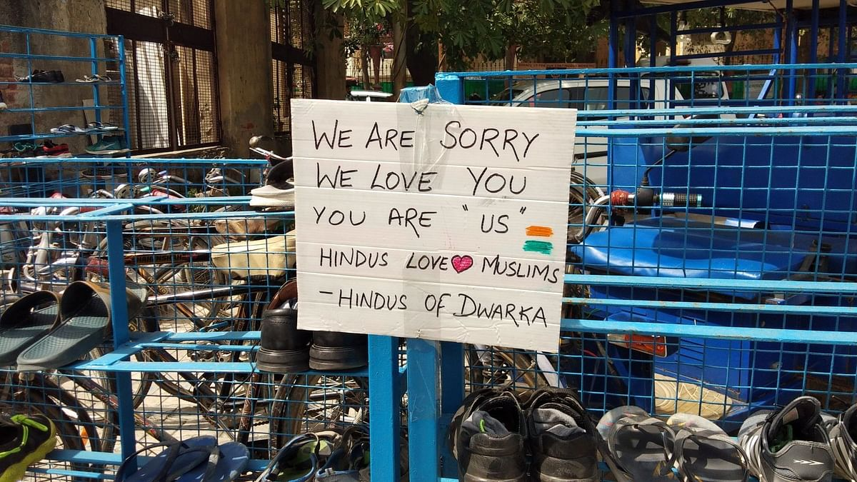 Hindus from the area put up posters of communal harmony outside the mosque in Dwarka