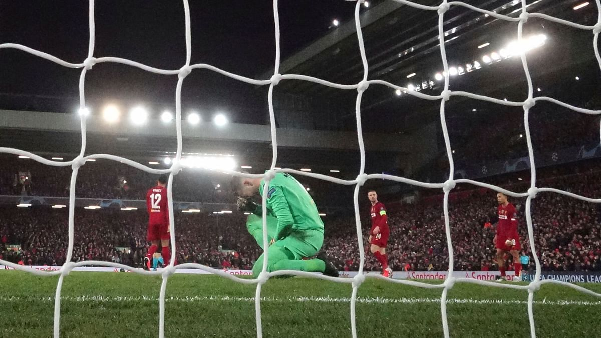 Liverpool's goalkeeper Adrian reacts after he fails to save the ball as Atletico Madrid's Marcos Llorente scores his side's second goal at Anfield stadium in Liverpool on Wednesday.