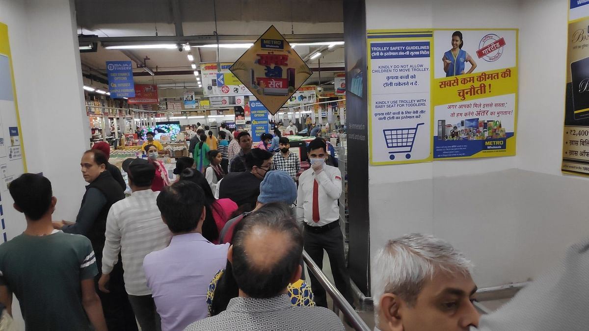 People engaged in panic buy in New Delhi after lockdown.