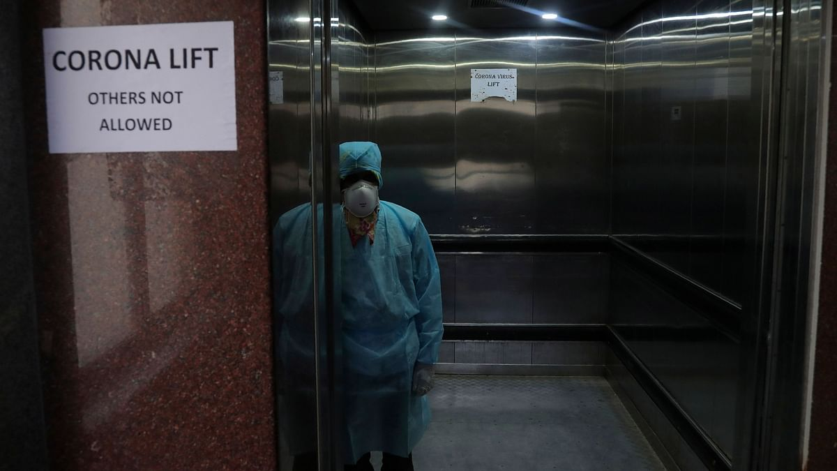 A lift operator stands inside a dedicated lift for people suspected to be infected with the new coronavirus. Representational image.