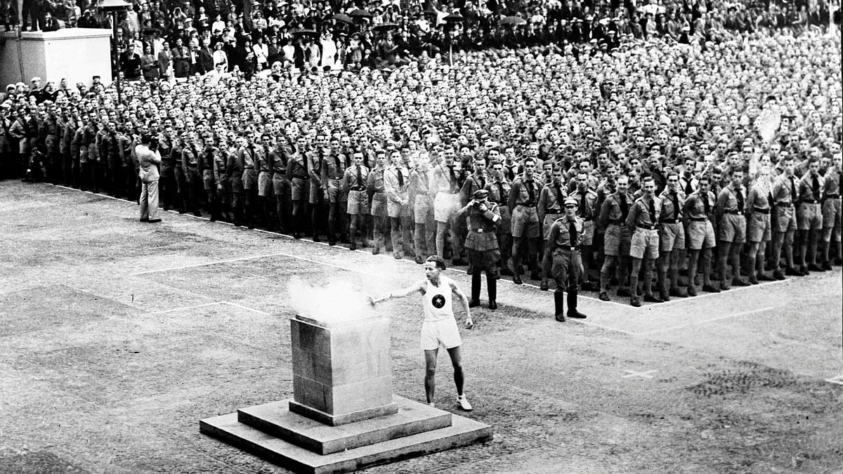 The lighting of the Olympic fire in Lustgarten, Berlin on Aug. 1, 1936, where it will be guarded by members of the Hitler Youth until it is brought to the Olympic stadium for the opening of the games in the afternoon.