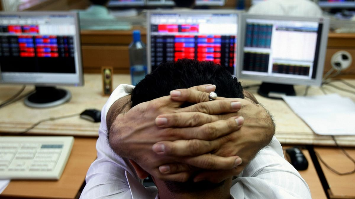 A broker reacts while trading at a stock brokerage firm in Mumbai.