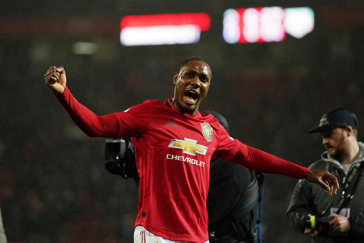 Manchester United's Odion Ighalo celebrates after the English Premier League soccer match between Manchester United and Manchester City at Old Trafford in Manchester.