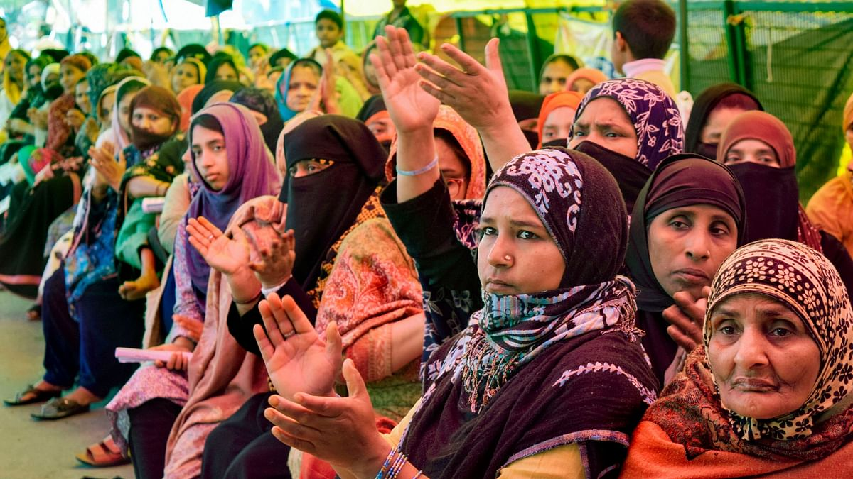 Women during a sit-in demonstration against CAA and NRC on International Women's Day at Shaheen Bagh in New Delhi.